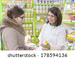 young female pharmacist in a... | Shutterstock . vector #178594136