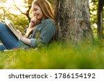 Beautiful Girl Reading A Book...