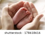 Mother Hold Feets Of Newborn...