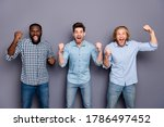 Small photo of Portrait of crazy football fan guy supporter pals watch football final celebrate national team victory wear checkered plaid shirt denim jeans isolated over gray color background