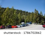 Austrian people and foreign travelers stop car in parking for travel visit viewpoint of Blindsee lake and rest dining at restaurant at Fernpass mountain passon September 20, 2019 in Biberwier, Austria - stock photo