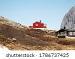 A Red Wooden Cabin In The...