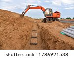 Excavator Dig The Trenches At A ...