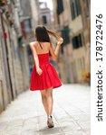Woman In Red Dress Walking In...