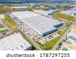 Aerial view of goods warehouse. Logistics center in industrial city zone from above. Aerial view of trucks loading at logistic center stock photo