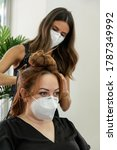 Elegant Young Hairdresser With...
