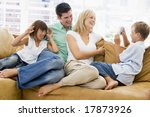 family sitting in living room...   Shutterstock . vector #17873926