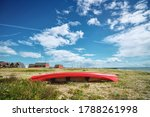 Red Kayak On The Shore In The...