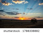 Small photo of The first rays of light. A beautiful sunrise in the desert just outside of Coolidge, Arizona. Coolidge is a farming community between Phoenix and Tucson.