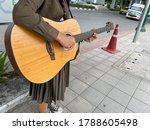Hands Of Guitarist Girl Playin...