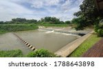 Small photo of Weir:Water management by creating a weir blocking the small water barrier in the upstream area to slow down the flow and prevent flooding in the rainy season.