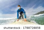 Front View Of A Surfer With...