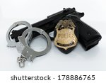 Police Badge  Gun And Handcuff...