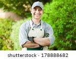 Portrait of a professional gardener  - stock photo
