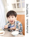 japanese boy eating meat | Shutterstock . vector #178891742