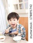 japanese boy eating meat | Shutterstock . vector #178891742