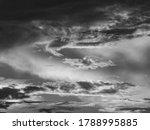Shifting Clouds At Sunset  In...