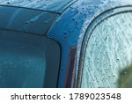 Automotive Industry. Clean and Wet Deep Blue Car Body Right After Pressure Washing Close Up. Cleaning Vehicle. - stock photo