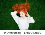 Redhead Woman Is Resting On...