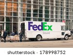 "Small photo of NEW YORK CITY - NOVEMBER 22, 2013: FedEx van delivering in downtown Manhattan. The name ""FedEx"" is the short version of the company original air division, Federal Express, which was used until 2000."