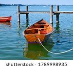 Small Wooden Boat On Pier....