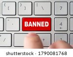 Small photo of admin bans the user. The red button on the keyboard of a notebook with the inscription of banned. The concept of blocking in the Internet