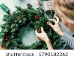 Woman Makes A Fir Wreath For...