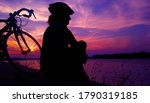 Silhouette Of A Woman Cyclist...