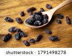 Dried Raisins On Wooden Spoon....