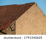 Heavily Damaged Roof Of An Old...
