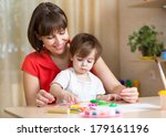 mother and kid at home | Shutterstock . vector #179161196