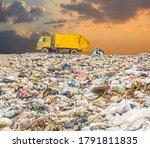 Garbage Truck Dump Pile In...