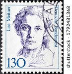 Small photo of MADRID, SPAIN - AUGUST 9, 2020. Stamp printed in Germany shows Lise Meitner, an Austrian-Swedish physicist who contributed to the discoveries of an element protactinium and nuclear fission