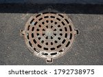 Round Grating Of The Sewer...