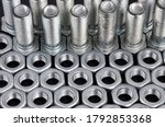 Metal Bolts And Nuts In A Row...