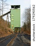 A Closed Down Coal Tipple with Empty Railroad Loading Track  - stock photo