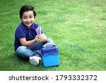 6 Year Old Latino Boy Sitting...