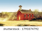 Small photo of Old Western Style School House & Church with a little wind Dustup