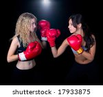 Two young ladies boxing - stock photo