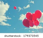 Bunch Of Red Balloons On A Blu...
