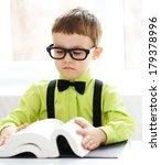 cute little boy is reading book ... | Shutterstock . vector #179378996