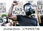 Activist Wearing Gas Mask...
