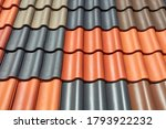 A roof is covered with different colored roof tiles. - stock photo