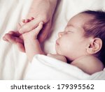 newborn baby and his father's... | Shutterstock . vector #179395562