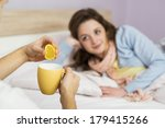 sick woman lying in bed with... | Shutterstock . vector #179415266