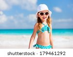 adorable little girl at beach... | Shutterstock . vector #179461292