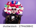 Small photo of Photo crazy funky dead bride demon witch lady face paint print telephone blogging direct finger empty space mexican culture floral headband black costume isolated purple violet color background