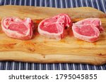 Three Uncooked Lamb Loin...
