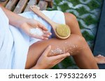 A Girl In A White Towel Sittin...