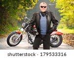 Mature Biker In Leather Jacket...